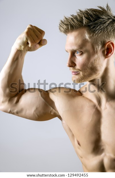 Biceps muscle of a young athletic blond man