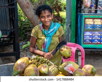 Bichitrapur, Orissa, India. - May31,2019. An unidentified young Indian girl Selling Coconut water at a local market.