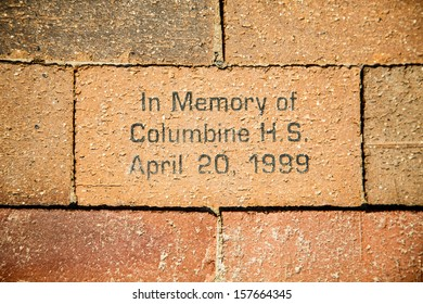 A bick in a sidewalk in Denver in memory of the Columbine High School shooting in Arip of 1999