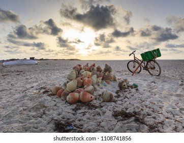 Bicycle abandoned  next to a pile of jars used to catch octupus