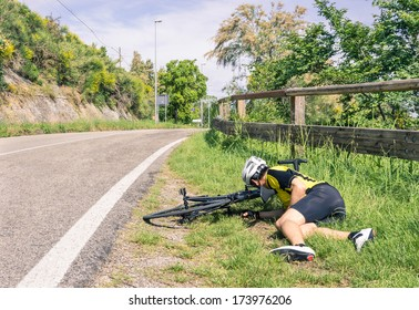 Bicycle accident on the road - Biker in troubles - Concept of sport failure and defeat during race competition