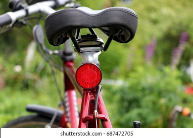 Bicycle back reflector, blurred background