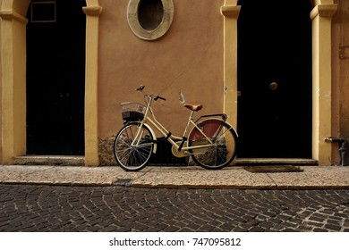 Bicycle with a basket against the wall. Verona, Italy