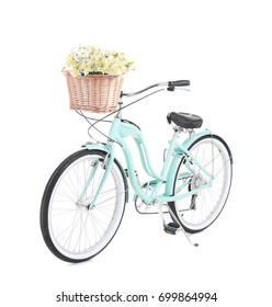 Bicycle with basket of beautiful flowers on white background