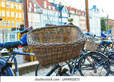 Bicycle with basket on Nyhavn (New Harbour) in Copenhagen, Denmark. Colorful old town architecture. Copenhagen style, European street, Denmark bicycle