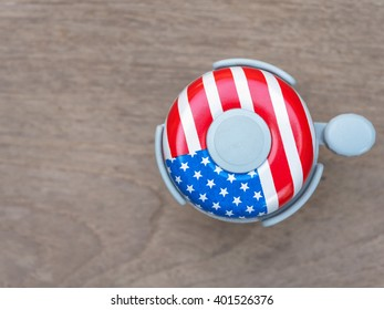 Bicycle bell pattern of the American flag on a wooden floor
