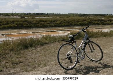 Bicycle beside salt pans in Il de Re.