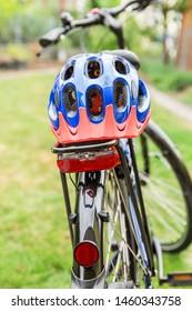 Bicycle with bike helmet on the rack