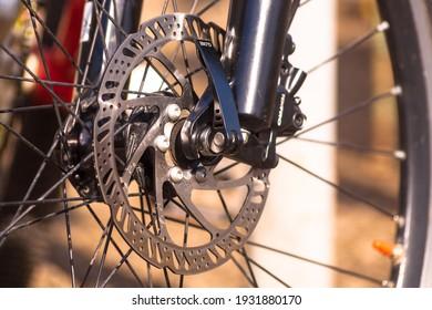 Bicycle brake up close. Bicycle wheel.  (Uzhhgorod, Ukraine - March 7, 2021)