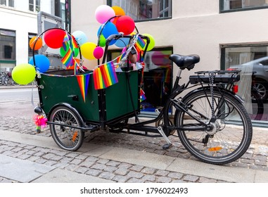 Bicycle with a cart decorated with colorful flags and balloons. Copenhagen.