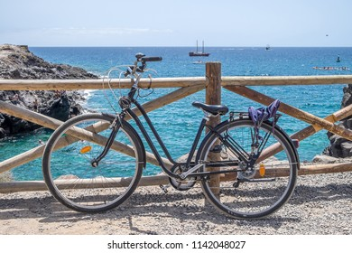 Bicycle and coast of Los Cristianos in the south of Tenerife, Canary Islands