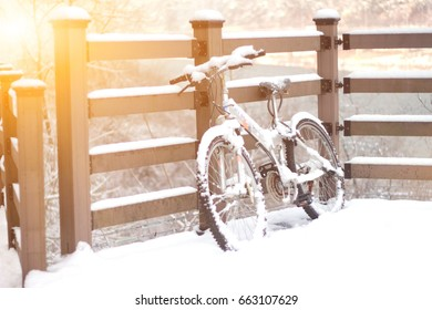 Bicycle covered with snow