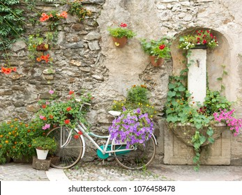 bicycle decorated with flowers in  Levico Terme, a village in the Italian Alps