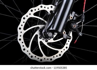 Bicycle disc brake on black background
