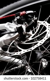 Bicycle disc brake .Rear disc brake on mountain bike . Visit my portfolio to see other photos of bicycle parts.