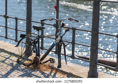 Bicycle dismantled connected to railing
