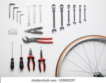 Bicycle fixing tool kit. Flat lay of work tools and bicycle wheel