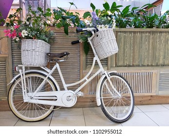 Bicycle with flowers basket. Girl bike in the shopping mall