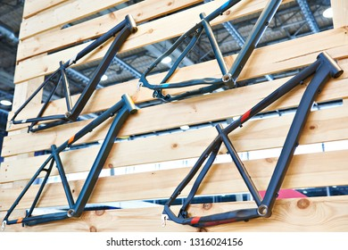 Bicycle frames on wooden wall in store
