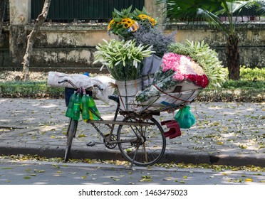 A bicycle with fresh flower for sale standing on the street, Hanoi, Vietnam.