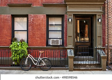 a bicycle in front of a brownstone building in neighborhood of Greenwich Village in Manhattan, New York City