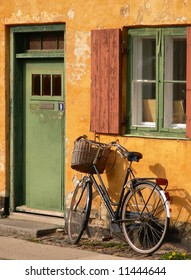 A bicycle in front of the entrance to an apartment in one of the houses named Nyboder