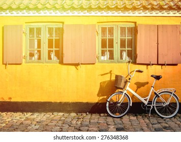 Bicycle in front of the entrance to an apartment in one of the houses named Nyboder