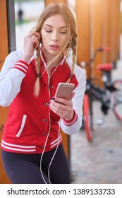 A bicycle girl resting listening to music on the headphones