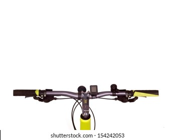 Bicycle handlebars isolated against a plain backgroubd