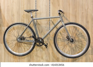 Bicycle hanged on wooden wall in small space apartment.