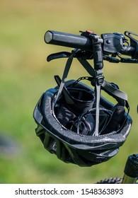bicycle helmet hanging on handlebar