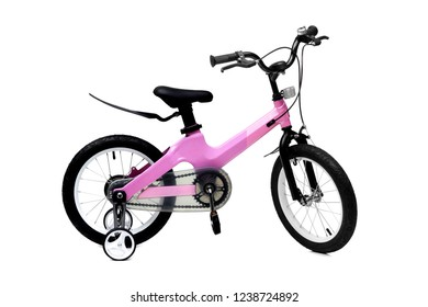 A bicycle for kid in pink color isolated background