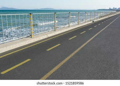 Bicycle lane along the sea in Burgas, Bulgaria. Cycling path in the city. Bicycle road.