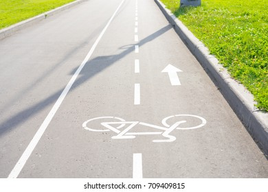Bicycle lane. Bike path with a symbol of bike through the grass in the town