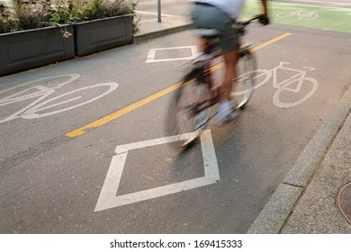 Bicycle Lane, Downtown Vancouver. A cyclist approaching an intersection using a designated bicycle lane which is separated from vehicle traffic in downtown Vancouver, British Columbia, Canada.
