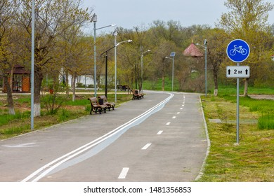 """The bicycle lane and footway separated by the traffic marking in the park """"The Friendship"""" in Elista city (Kalmykia, Russia)."""