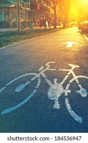 Bicycle lane mark on the street in sunset
