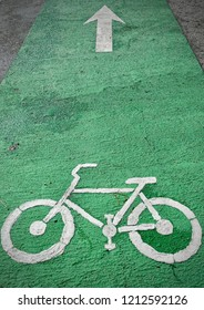 bicycle lane on the pavement road in public park. Bike lanes or cycle lanes are types of bikeways (cycleways) with lanes on the roadway for cyclists only.