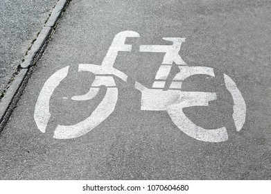 Bicycle lane road sign on gray asphalt