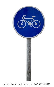 Bicycle lane road sign on pole post, large blue round isolated bike cycling on white background.