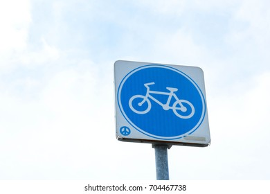bicycle lane sign and blue sky