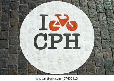 Bicycle lane sign on a bricked street of Copenhagen, Denmark
