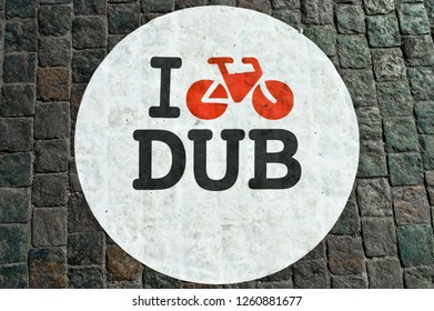 Bicycle lane sign on a cobblestoned street in Dublin, Ireland.