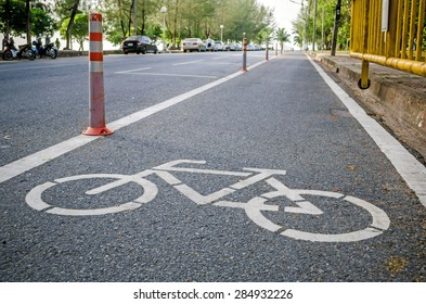 bicycle lane sign on the road