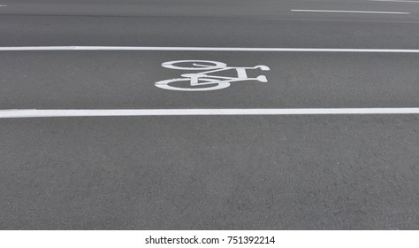 Bicycle lane sign on the road surface