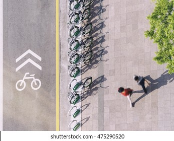 Bicycle Lane signage with bicycle parking on street People walking Urban city top view