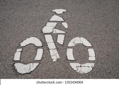 Bicycle lane symbol on road.