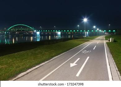 Bicycle lane with white bicycle sign at night