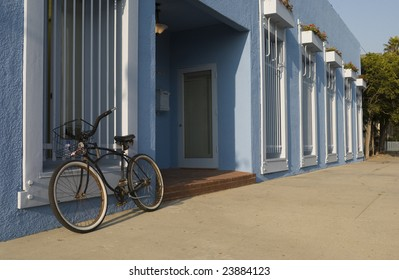Bicycle leaning against blue building  Venice Beach, California, USA