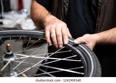 Bicycle mechanic repair bike wheels